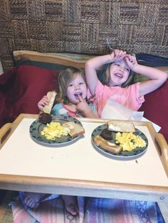 Ellie and Kinsley enjoying  b'fast in bed, 5-11-17.