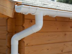 Guttering, including running outlet, offsend bends and round downpipe.
