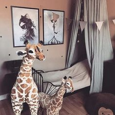 You just have to love these big giraffes... and the colour of the walls  photo by @klaracornefelt #missklara #missgertrud #circusmighetto #mrsmighetto #kids #kidsroom #kidsdecor