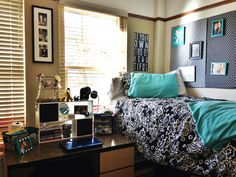 Turquoise Dorm room at Texas Tech! I used cardboard posters from Walmart and wrapped them in fabric to make the bulletin behind my bed! Super cheap. Horn/knapp