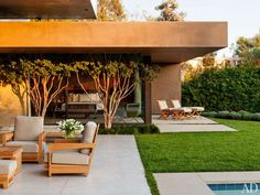 The main terrace boasts a suite of Sutherland teak furniture cushioned in a Perennials fabric, at this Beverly Hills home.