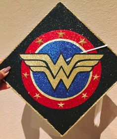 Show off your superhero style on graduation day and decorate a cap featuring your favorite character. This graduate has a love for Wonderwoman.