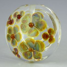 a clear large lentil focal with delicate pastel multicolored buds handmade lampwork glass bead - Barely There