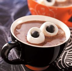 {Eyeball Hot Chocolate....Hot Chocolate + 2 Marshmallows + 2 Peanut M & M's}..You can use Junior Mints, Reese's Cup Mini's or Mini Mounds...whatever Flavor You Wish!!!
