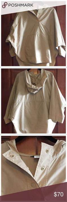 J.Crew XS Hooded Cotton Slicker in Khaki J.Crew XS Hooded Cotton Slicker in Khaki. Lightweight fabric. Kanga pocket, snap placket in front. Oversized, exaggerated silhouette. Only worn once, like new condition! Feel free to ask any questions below! J. Crew Jackets & Coats