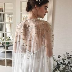 Alexandra Grecco's #Spring2018 #Stardust collection.e concept of wearing a sheer cape