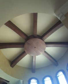 Wood beams in flat round ceiling recess