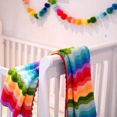 rainbow blanket and pom pom garland