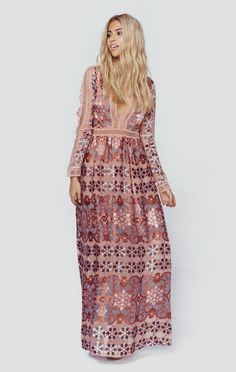 """The Juliet Maxi Dress by For Love and Lemons is a vision with the brand's signature floral print on a silk satin burnout, mini ladder cut-out trim, nude bodysuit lining with deep v neckline, and flowing body. Made in USADry Clean OnlyPoly BlendFit Guide:Model is 5ft 7 inches; Bust: 34"""", Waist: 23"""", Hips: 34""""Model is wearing a size XSRelaxed FitShoes Featured Not Available For Purchase"""