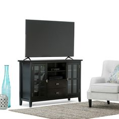Simpli Home Artisan Solid Wood 53 in. Wide Contemporary TV Media Stand in Black for TVs Upto 55 in. – The Home Depot Simpli Home Artisan Black Tall TV Media Stand – – The Home Depot Tall Tv Stands, 60 Tv Stand, Open Shelving, Adjustable Shelving, Shelves, Tv Media Stands, Solid Wood Tv Stand, Storage Cabinets, Storage Spaces