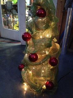 Tomato cage with lights covered with mesh ribbon - with a bit more decorations added, I could pull this off.