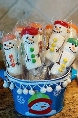 "Marshmallow Snowmen ""On a Stick"", white chocolate covered.  M buttons,"