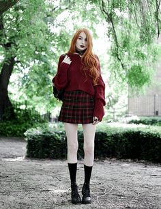 Olivia Emily wears River Island Studio Red Jumper, Topshop red plaid check skirt, Killstar Heart Choker, and Unif Dedi Boots