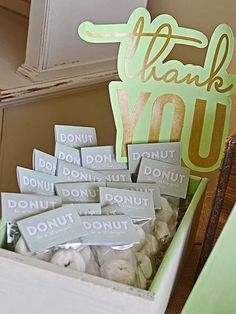 The idea of handing out adorable mini donuts to your guests to thank them for attending a baby shower is definitely something we can get on board with.