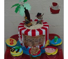 Jake the Pirate Cake and Cupcakes. Cupcake toppers, coins, beach, treasure map, Jake the pirate and alligator all hand made from fondant. Find more of my work on my Facebook page, Driving Me Cakey. Located Fairview Park, South Australia.