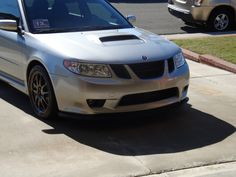blacked out grill, and split 5 spoke rims on saabaru