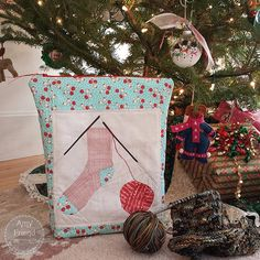 Who is making Christmas gifts? I am! I just finished this Knitting Socks block from my pattern by that name. I used a knit-look fabric for the sock. And I used a script print in two different d…