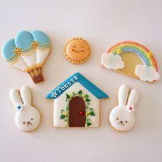 Bunnies, hot air balloon, rainbow, sunshine, and cute little house