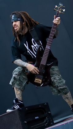 "Korn. This guy plays bass like no other! Amazing. ""Fieldy"""