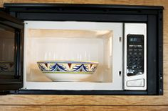 THE BEST MICROWAVE CLEANING TRICK EVER  1. Put 1-2 C water and a handful of lemon slices in a microwave-safe bowl. (Lemon juice works, too.)  2. Heat the bowl in the microwave for 3-5 min, or til boiling.  3. When you hear the buzzer, wait two minutes before opening the door. This will give the steam time to loosen food particles and allow the lemon to spread a fresh, citrus scent.  4. Carefully remove the bowl and wipe down the inside of the microwave with a warm, moist cloth.