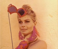 Candice Bergen. Red orange and pink. So hot.