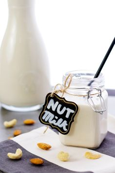 Poured homemade vegan nut milk made from cashews and almonds