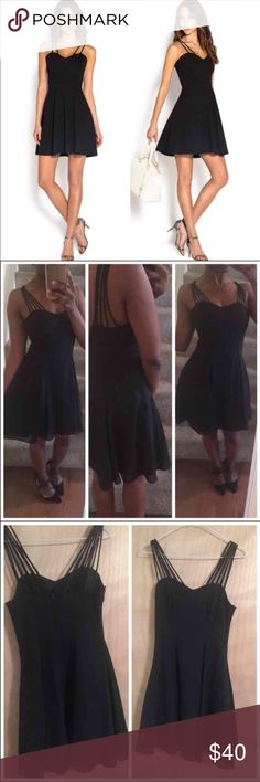 Multi-strap Black Cocktail Dress I wore this one time and its already too small. It wont zip up on me but the zipper works fine. Great condition, I have not found any flaws in it. Fits like an XS. Size 3/4 in Jump. Sizing chart is shown in photos. True to size! Lined. Related Tags: gown, formal, full length, prom, evening, gala, white, ivory, pearl, homecoming, party, dance, occasion, jovani, windsor, asos, bcbg, zara, asos, river island, bebe, michael kors, davids bridal, ceremony sherri…