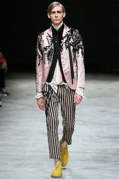 Ann Demeulemeester presented a romantic and dark Spring/Summer 2014 collection during Paris Fashion Week, featuring formal tailoring, stripes and velvet flowers all over the collection.