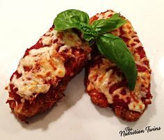 Crispy Chicken Parmesan |  Quick, easy, delicious & HEALTHY!  |  Fear not when it comes to breading with this recipe! Perfect for serving at dinner parties AND great for leftovers too! | NutritionTwins.com