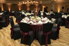 love the burgundy chair sashes and table cloth. the branch centerpieces are pretty as well
