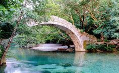 The iconic images of the Zagori region are the 92 arched stone bridges that cross the rivers and link the paths Mountain Village, Mountain View, Places In Greece, Seaside Resort, Life List, Mykonos, The Good Place, Medieval, Bridge