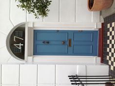 Blue door, black & white tiles. Delightful.