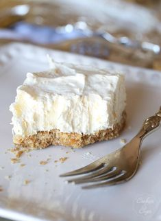 Potluck Cheesecake Dessert. Nilla Wafer crust filled with a fluffy cream cheese, crushed pineapple and Cool Whip filling.