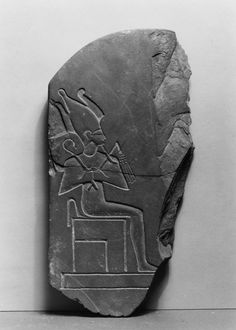 Ancient Egyptian slate fragment portraying an enthroned Osiris, wearing an plumed atef crown and holding a crook and flail. (Walters Museum)