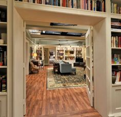 The Good Wife: Library shelves built around doorway; Large Rug; Blue Sofa
