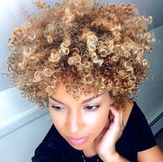 Blonde highlights and lowlights on natural hair curls.