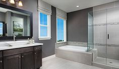 This modern master bath in Mountain House, CA, boasts a separate shower and soaking tub | Charlene plan by Richmond American