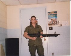 Another M60 pose. Nice Iron Maiden poster in background.