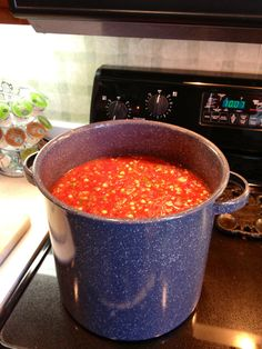 A pot full of fresh salsa ingredients getting ready for canning.
