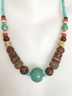 Statement necklace, turquoise necklace, mixed with vintage beads, Tibetan Bodhi beads,ceramic beads, clay beads, 20mm large round turquoise beads centre piece, beads graduating 4mm faceted turquoise beads with lobster clasps.21 inches in length and weighs 41.50 grams.Ready to ship. Thank