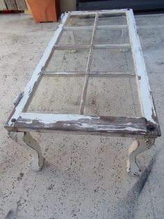 repurposed  Vintage Window Coffee Table; add old salvaged legs to wooden window; Upcycle, Recycle, Salvage, diy, thrift, flea, repurpose!  For vintage ideas and goods shop at Estate ReSale & ReDesign, Bonita Springs, FL