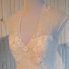 Pretty details on the bodice of this gown by Melissa Sweet for David's Bridal