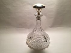 Vintage Crystal Decanter With Silver Stopper From by GWMcGinneys