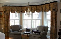 adorable brown patterned curtain design with white drape on large arched bay window with sofa designs beneath white ceiling idea