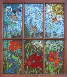 """Garden View"" was created with hand cut stained glass, glass gems, beads and pebbles directly applied to a 26"" by 32"" vintage window.  Mosaic artist - Victoria Gilpin, Toledo, Ontario"