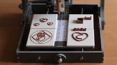 A 3-D chocolate printer - actually can shape chocolate into any shape without a mold - where can I get a hold of one of these?