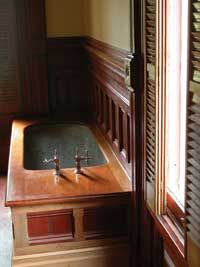 The typical mid-19th-century bathtub was a product of the tinsmith's craft, a shell of sheet copper or zinc. In progressive houses equipped with early water-heating devices, a large bathtub might be site-made of sheet lead and anchored in a coffin-like wooden box.