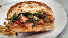 The closeup ~ Porchetta #sandwich at @BottegaLouie ~ #roasted #pork, #carmalized #sweet #onions, #Peppadew #peppers, #arugula and #brined #caper #aioli