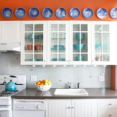 We love the fun and sophisticated look of this glass tile backsplash! More kitchen backsplash ideas: http://www.bhg.com/kitchen/backsplash/kitchen-tile-backsplash-ideas/?socsrc=bhgpin082013glasstile=13