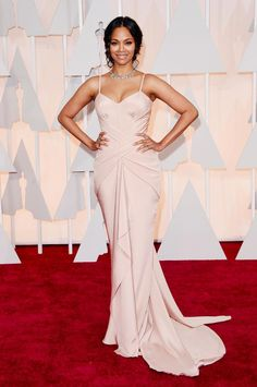 Gorgeous @zoesaldana just stepped out at the Academy Awards looking flawless in Atelier Versace! #Oscars2015